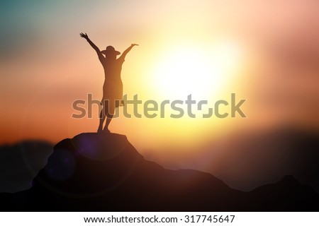 Silhouette in lady rocky cave on the sunset background