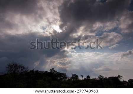 silhouette landscape and Sky with light beam pass clouds