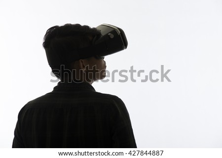 Silhouette man portrait, using the virtual reality headset