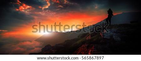 Beautiful Autumn Sunrise European Landscape Mountains Stock Photo - This man hikes up the transylvanian mountains every morning to photograph sunrise