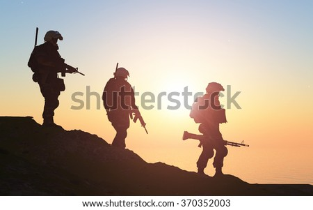 Silhouette of a group of soldiers at sundown.