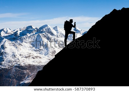 Silhouette Man Standing On Top Mountain Stock Photo