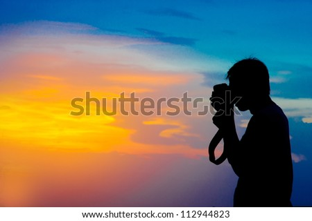 Silhouette of a photographer in the nature