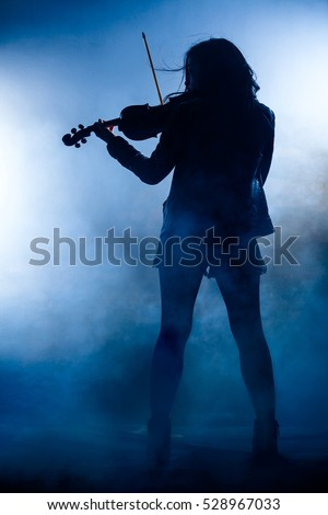 Silhouette of a Rock Woman with Leather Jacket Playing a Violin