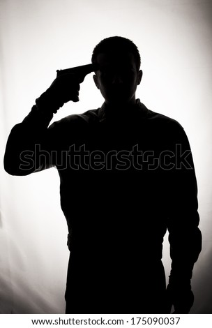 Silhouette Of A Suicidal Man Stock Photo