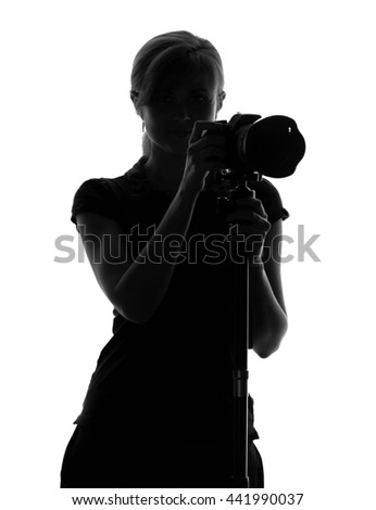silhouette of a woman with a camera