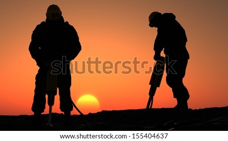Silhouette of a worker at sunset.