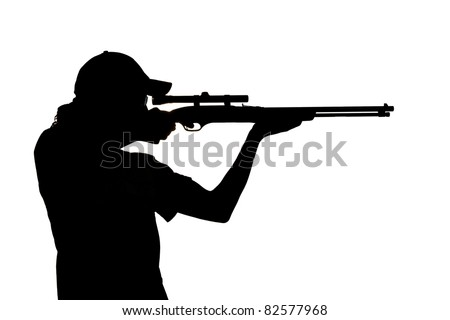 Silhouette of a young man with ponytail shooting with a rifle