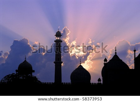 Silhouette of great mosque of Old Delhi, India, at sunset.