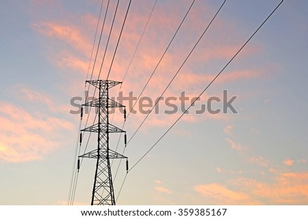 silhouette of high voltage electric tower with beautiful twilight  background