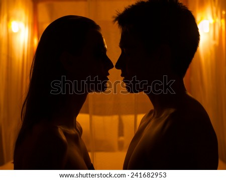 Silhouette of romantic couple in a hotel setting