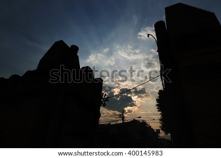 Silhouette of Tha phae gate (the historical gate of chiangmai,famous tourist attraction) ,Chiangmai landmark over blooming sky,Travel background