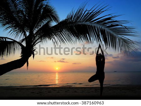 Silhouette one woman with professional yoga posture on the beach at sunset.