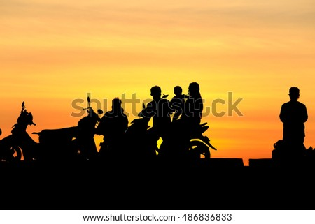 Silhouette people and family on motorcycle at sunset, silhouette photo