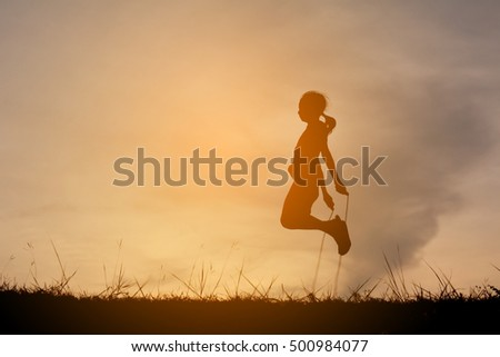 Silhouette young girl rope jumping on the sunset. Time on holiday happy and fun , vintage tone