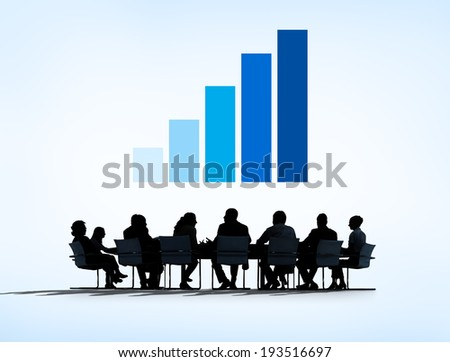 Silhouettes of Business People Having a Meeting and Graph Above