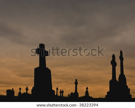 Silhouettes of Christian and Celtic crosses against a colored cloudy sky. Perfect for Halloween!