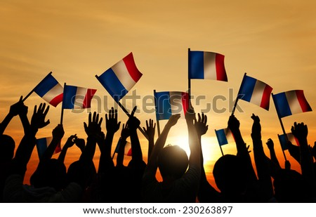 Silhouettes of People Holding the Flag of France