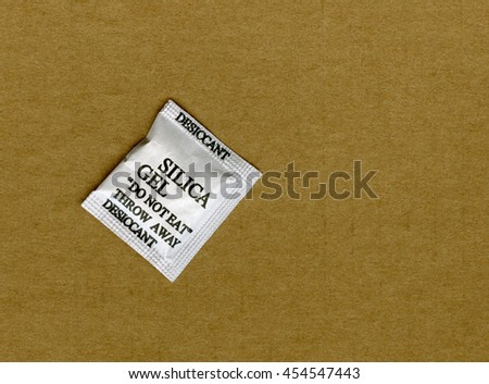 Silica Gel packet on cardboard