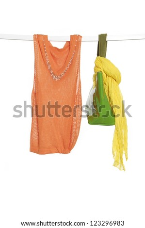 silk fabric of scarf and bag with clothing on a hanger