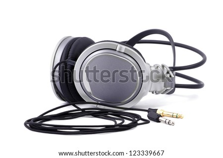 Silver and black headphones closeup, isolated over white