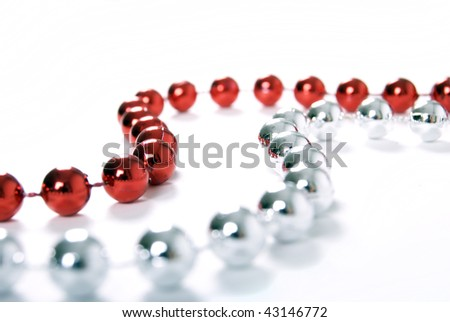 Silver and red beads isolated on white