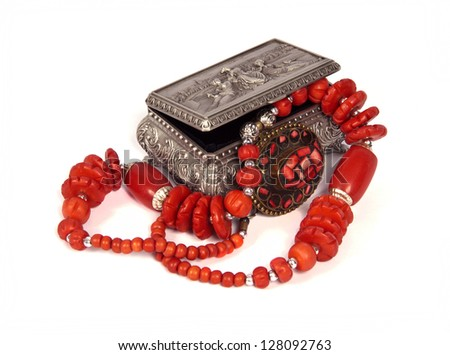 silver box with red beads on a white background