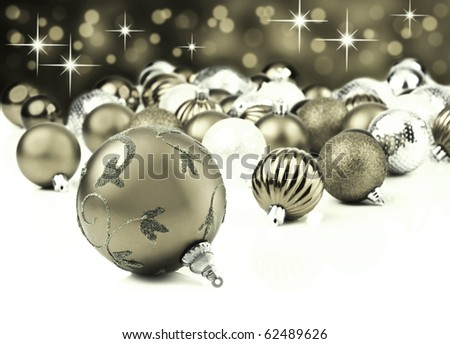 Silver christmas decoration baubles on white with space for text