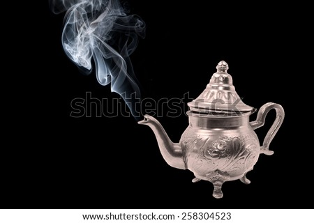 silver teapot with grey smoke