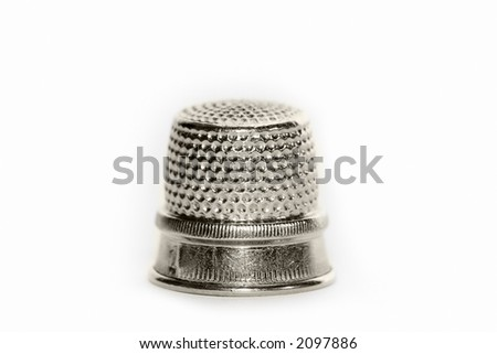 silver thimble on a white background isolated