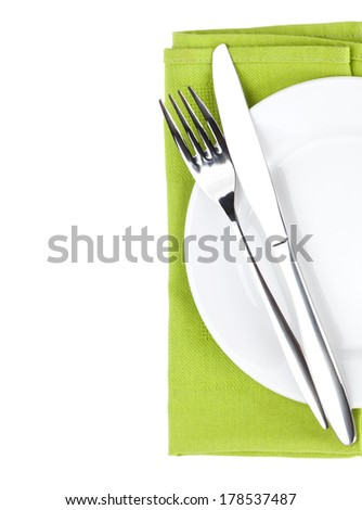 Silverware or flatware set of fork and knife over plate. Isolated on white background