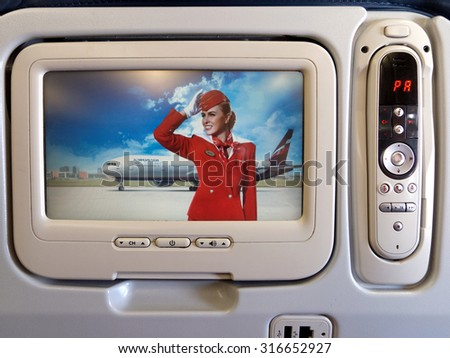SIMFEROPOL, RUSSIA - August 31, 2015: Retro stewardess in the monitor of multimedia system Airbus A330 Aeroflot airlines