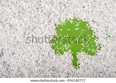 simple green tree symbol made inside big heap of shredded paper