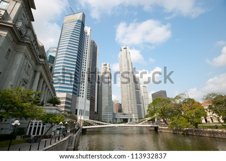 SINGAPORE - APRIL 23:Office towers rise at the banks of the river. Singapore has a highly developed market-based economy and is a center for commerce in Asia. April 23, 2011 in Singapore, Singapore