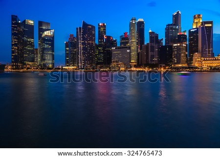 SINGAPORE CITY, SINGAPORE - AUGUST 16, 2015: Cityscape of financial district during twilight on August 16, 2015 at Marina Bay, Singapore.