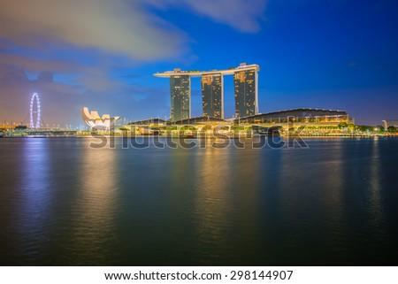 Singapore City, Singapore - July 18, 2015: Marina Bay is a bay near Central Area in the southern part of Singapore, and lies to the east of the Downtown Core.