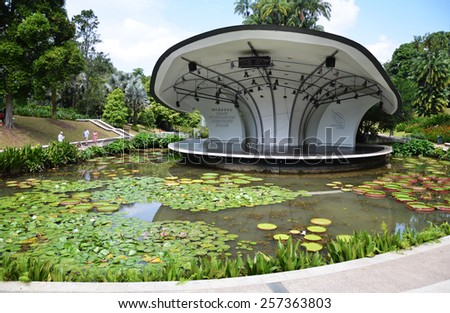 Old abandoned drought rusty draw well stock photo for Au jardin singapore botanic gardens