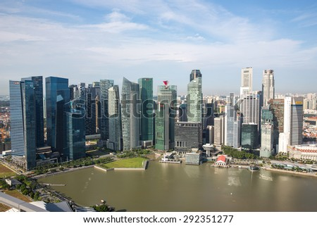 Singapore - January 7, 2015: View of Downtown district in Singapore from the famous Marina Bay Sands infinity pool.