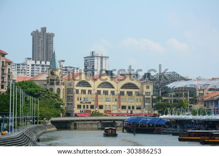 SINGAPORE - JUL 16, 2015. Colorful buildings in Clarke Quay, Singapore. Clarke Quay, is a historical riverside quay in Singapore, located within the Singapore River Area.