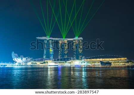 SINGAPORE - MAY 23: Marina Bay Sands hotel light show at night on May 23, 2015 in Singapore. It is the world's most expensive building with cost of US$ 4.7 billion and landmark of Singapore.