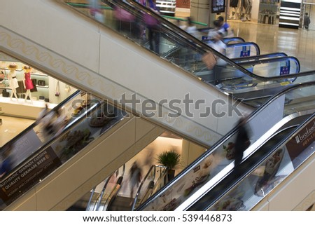 SINGAPORE, 15 MAY 2015 Motion blur of people rushing in the shopping mall.