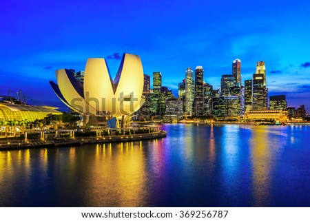 Singapore Skyline and view of Marina Bay at twilight.