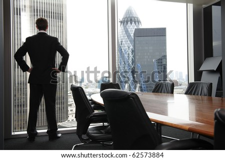 Single adult business man waiting for meeting to begin in Board room