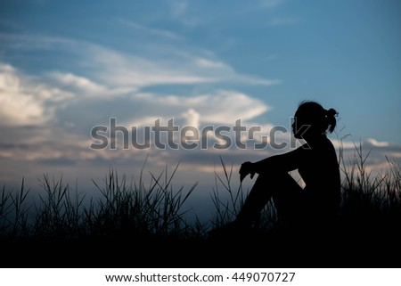 Single adult woman silhouette and sunset