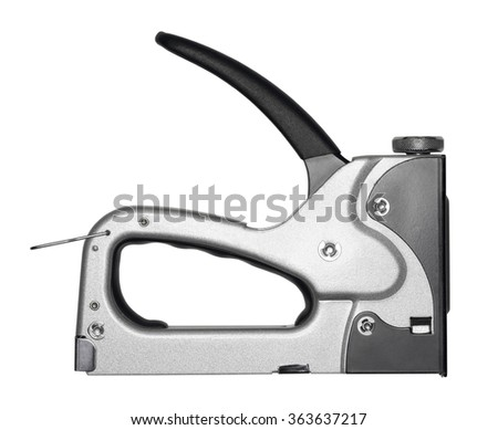Single gray metal stapler. Isolated on white background. Close-up. Studio photography.