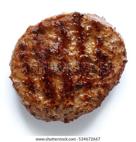 Single grilled hamburger patty isolated on white from above.