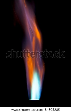 Single intense gas jet flame against a black background
