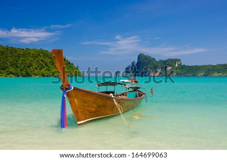 Single longtail boat on the Loh Dalum beach, Phi-Phi Don island