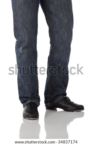 Single male tap dancer wearing jeans showing various steps in studio with white background and reflective floor. Not isolated