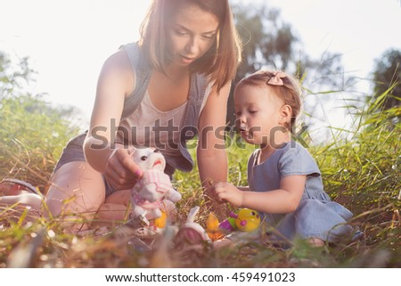 Single Mother have picnic with toddler girl in park